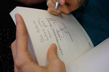 Jenny Rohn signs her first copy of Experimental Heart for a reader